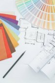 Interior designer working table with drawing, sample fabric and color palette