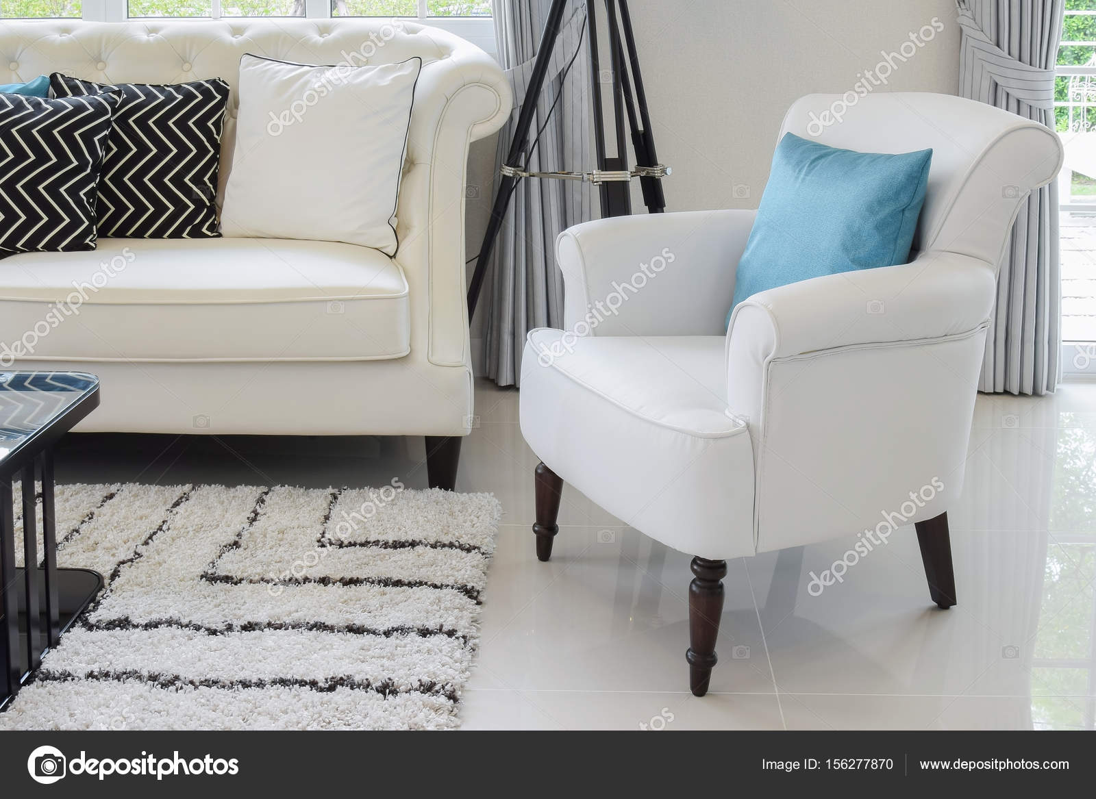 white and blue pillows on a white leather couch in vintage living ...