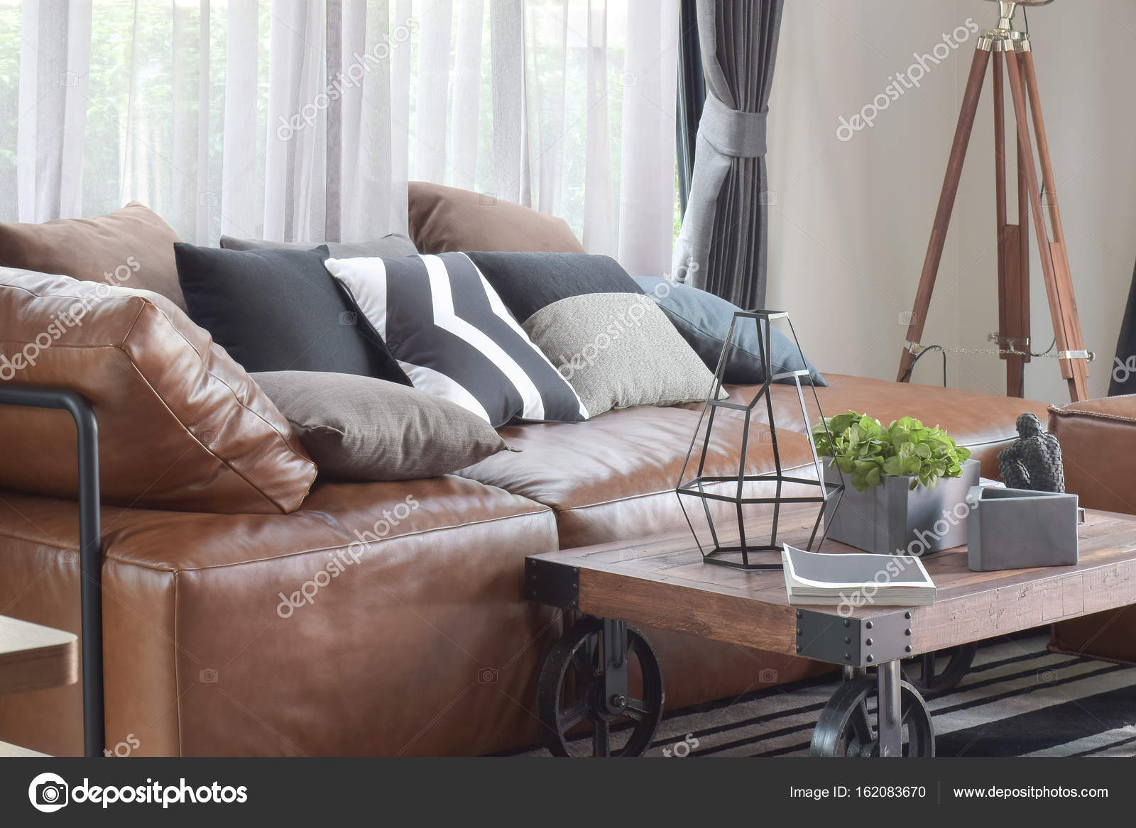 Wood Center Table With Wheel And Light Brown Leather Sofa In Industrial Style Decoration Stock