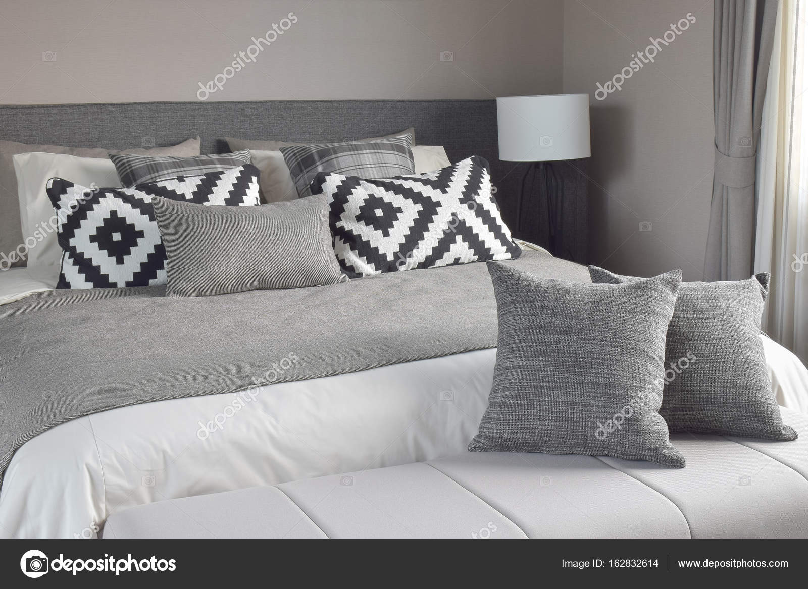 Graphic Style And Grey Shade Pillows On Classic Color Bedding Set Up U2014  Stock Photo