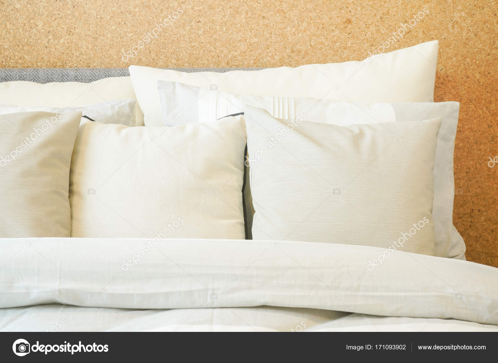 closeup roll of pillows on comfy bed stock photo worldwide stock