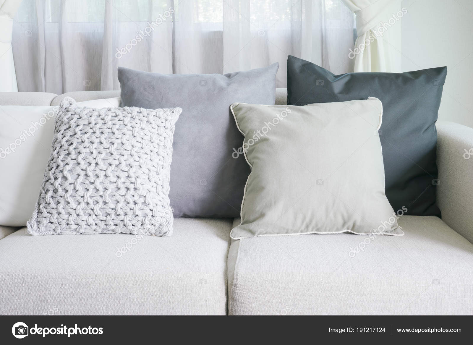 https://st3.depositphotos.com/6200870/19121/i/1600/depositphotos_191217124-stock-photo-light-gray-sofa-set-with.jpg