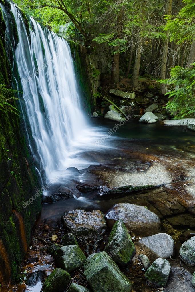Waterfall In Beautiful Scenery Stock Photo