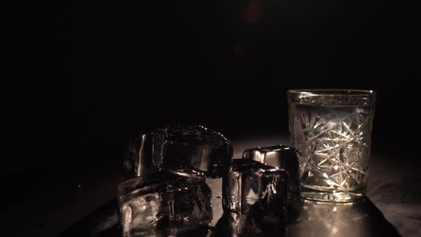 A glass of sambuka and a pyramide from ice