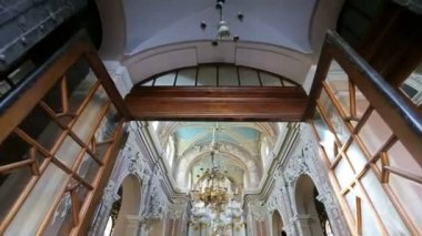 Walk through the magnificent white church decorated with white figures and flowers