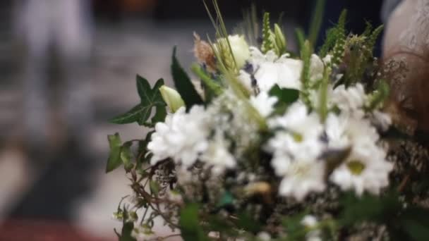 The close-up portrait of the wedding bouquet consisted of daisies and white field flowers.