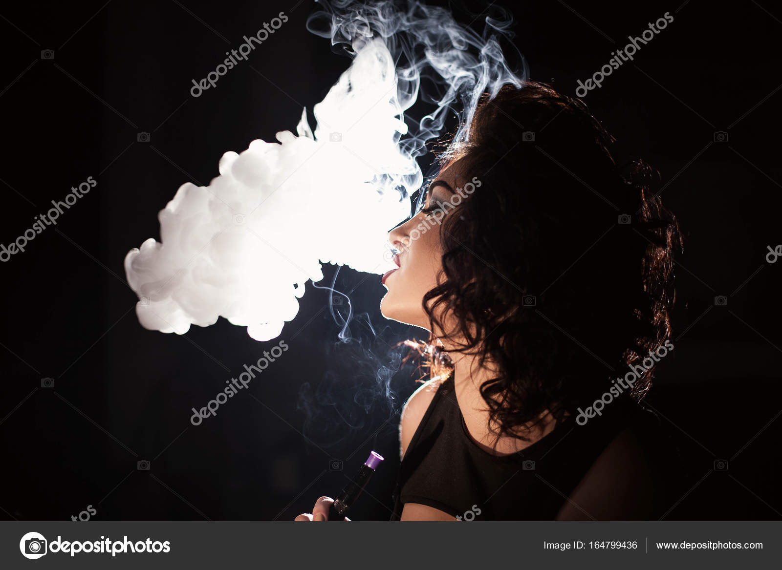 Charming brunette exhaling hookah smoke  — Stock Photo