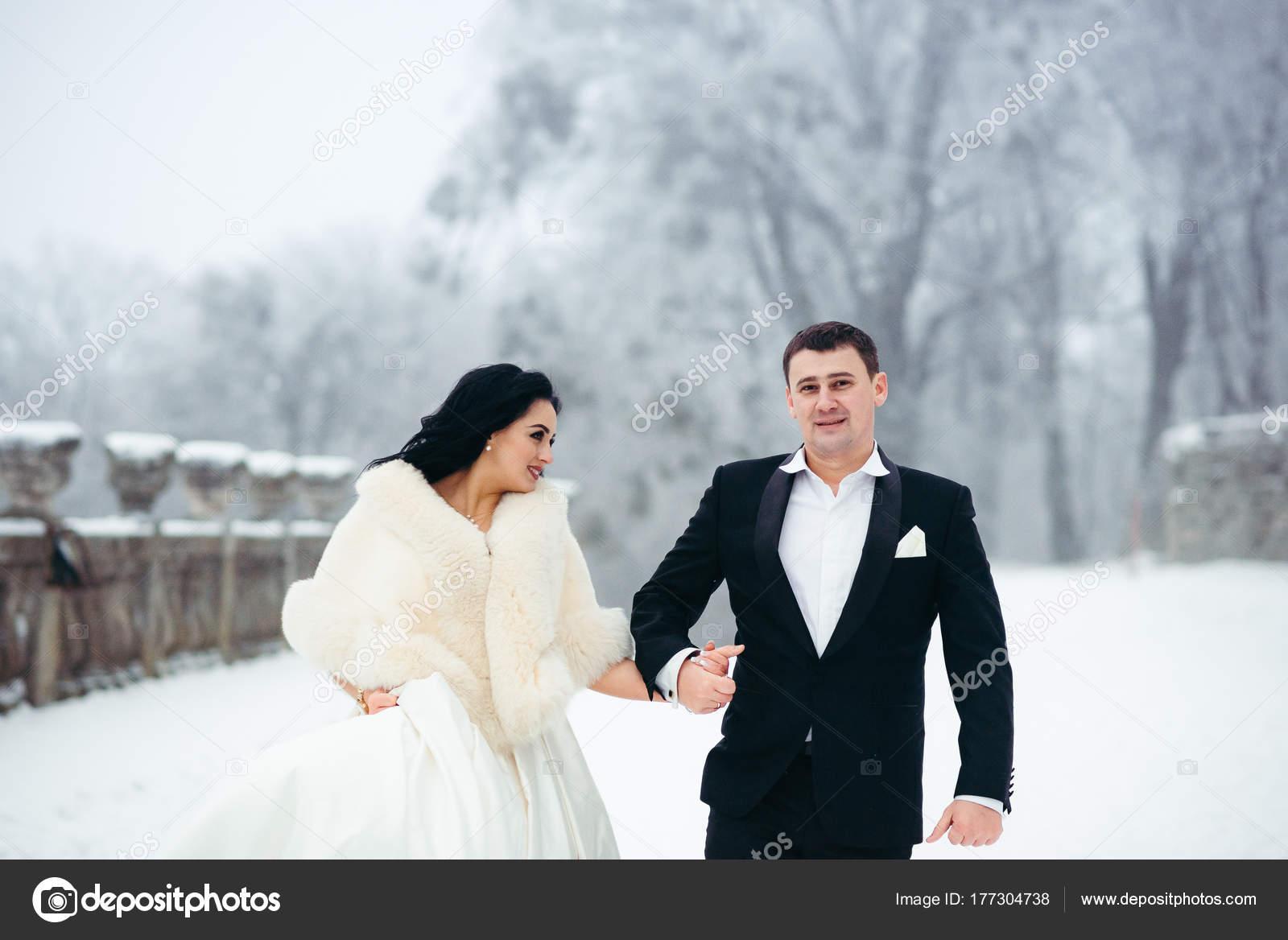Happy Beautiful Newlyweds Couple Holding Hands Walking Snowy Path ...