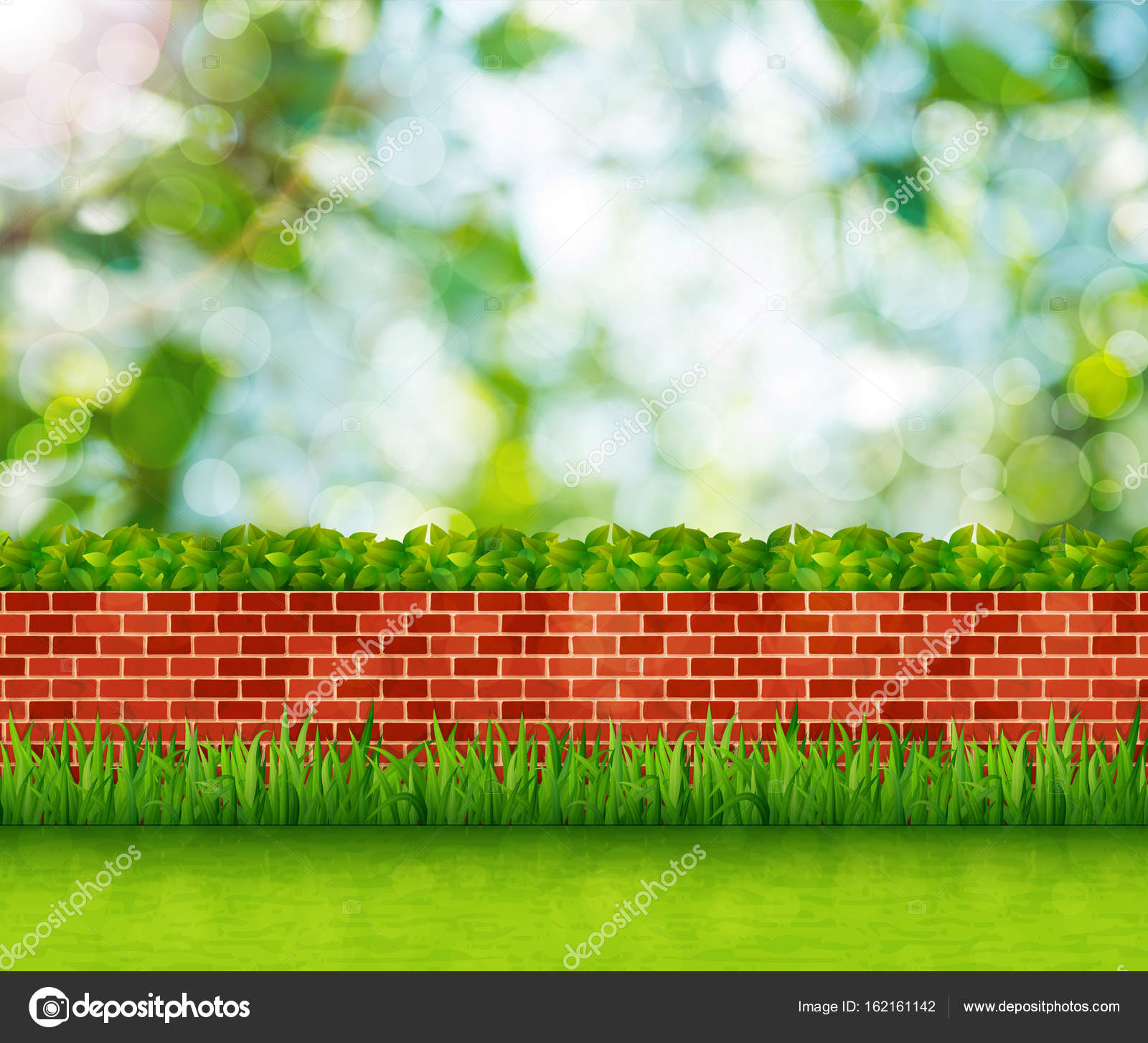 Garden Background With Brick Wall And Green Grass Stock Photo