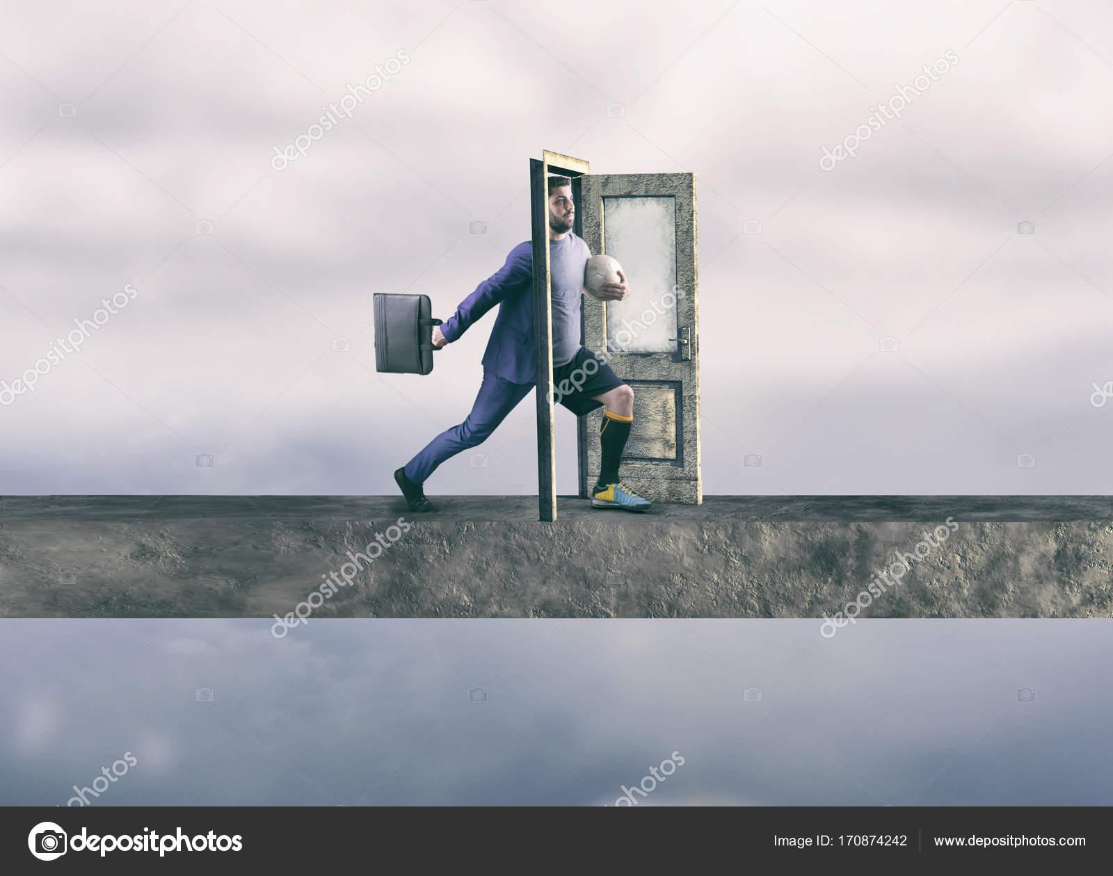Businessman stepping through door to a soccer player. Half business man half soccer player. u2014 Photo by ALLVISIONN & Stepping through door u2014 Stock Photo © ALLVISIONN #170874242
