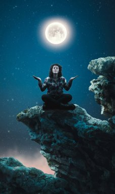 Woman meditates on top of a rock into the night. stock vector