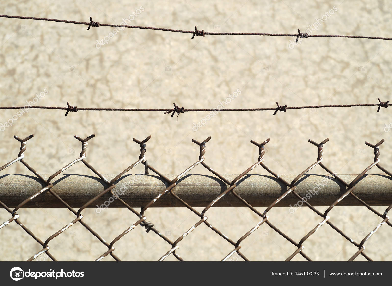 barbed wire fence on concrete background — Stock Photo ...