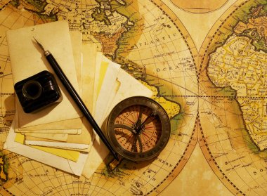 Compass and letters over map