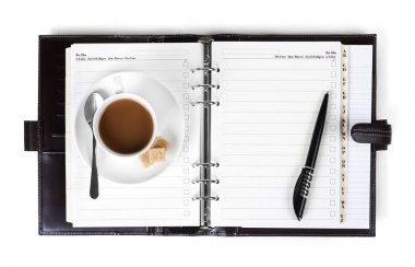 Coffee on notebook