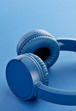 Blue wireless headphones close-up