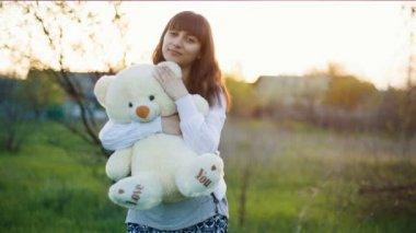 Woman hugs teddy bear