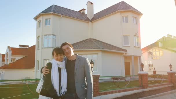 Family in front of new house