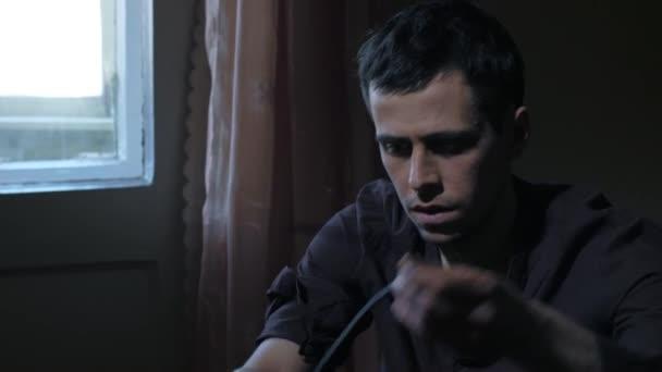 Addict making syringe injection of heroin