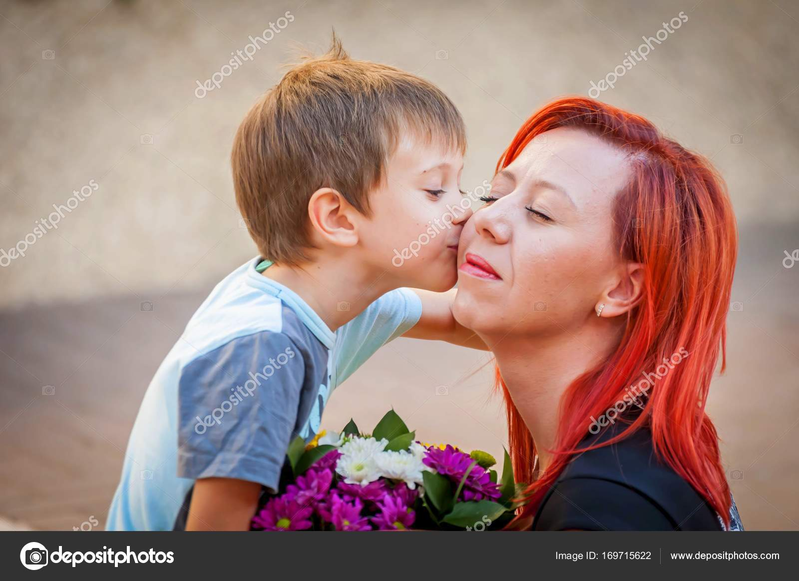 little cute boy kissing his mother stock image — stock photo