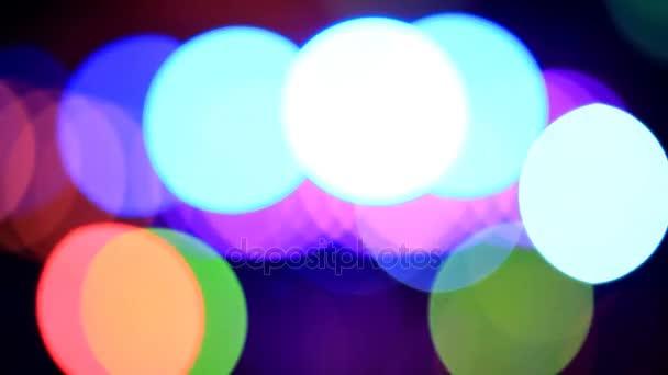 Pohybující se částice. Barevné, rozmazané, bokeh pozadí světla. Abstraktní jiskří