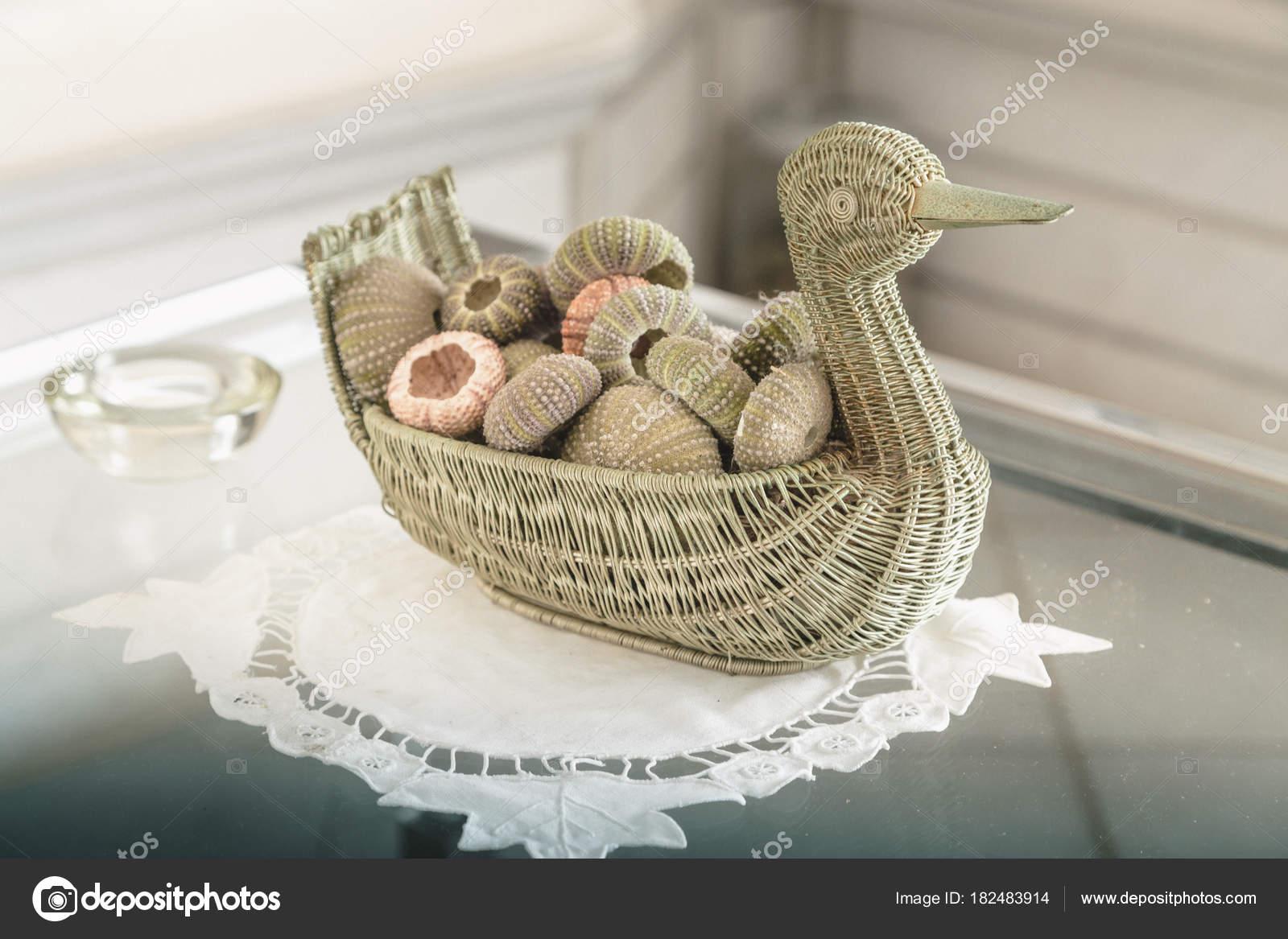 Home Decor Close Up Of Ornamental Decorative Balls In A Woven Stock Photo