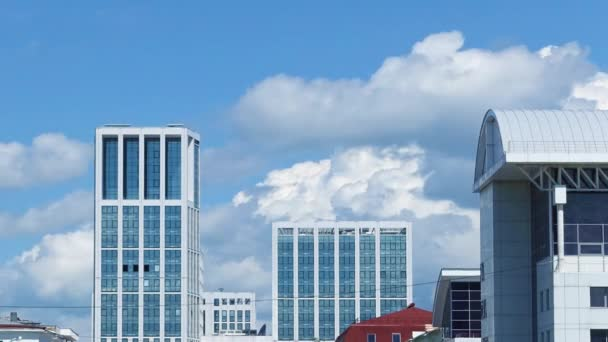 Office building on a background of clouds