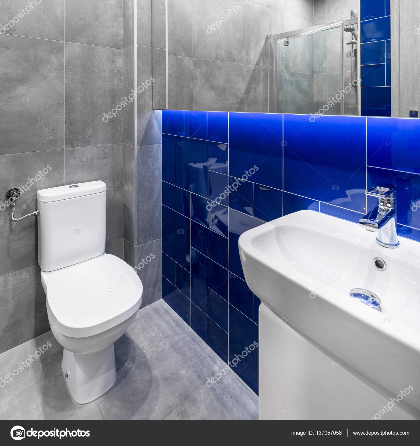 Small grey and blue bathroom — Stock Photo © in4mal #137057058