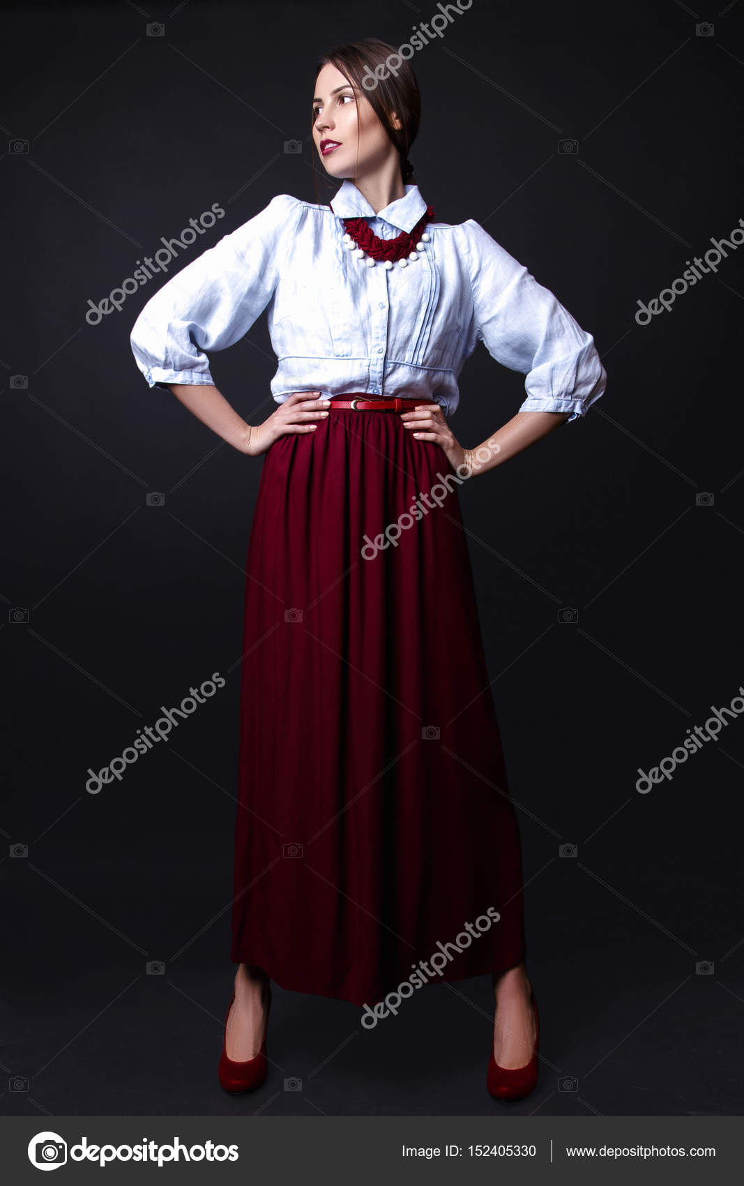 65f8a6f1b6 Young sexy girl. Fashion portrait of young beautiful woman in skirt and  shirt. Black background — Photo by ...