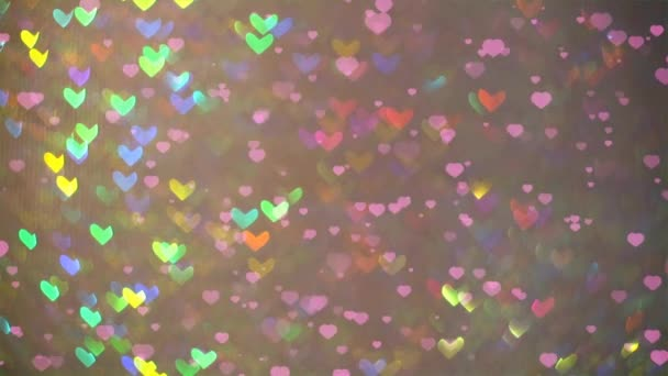 little hearts falling on the floor and blur rainbow shape heart background