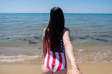Follow me in the American flag swimsuit