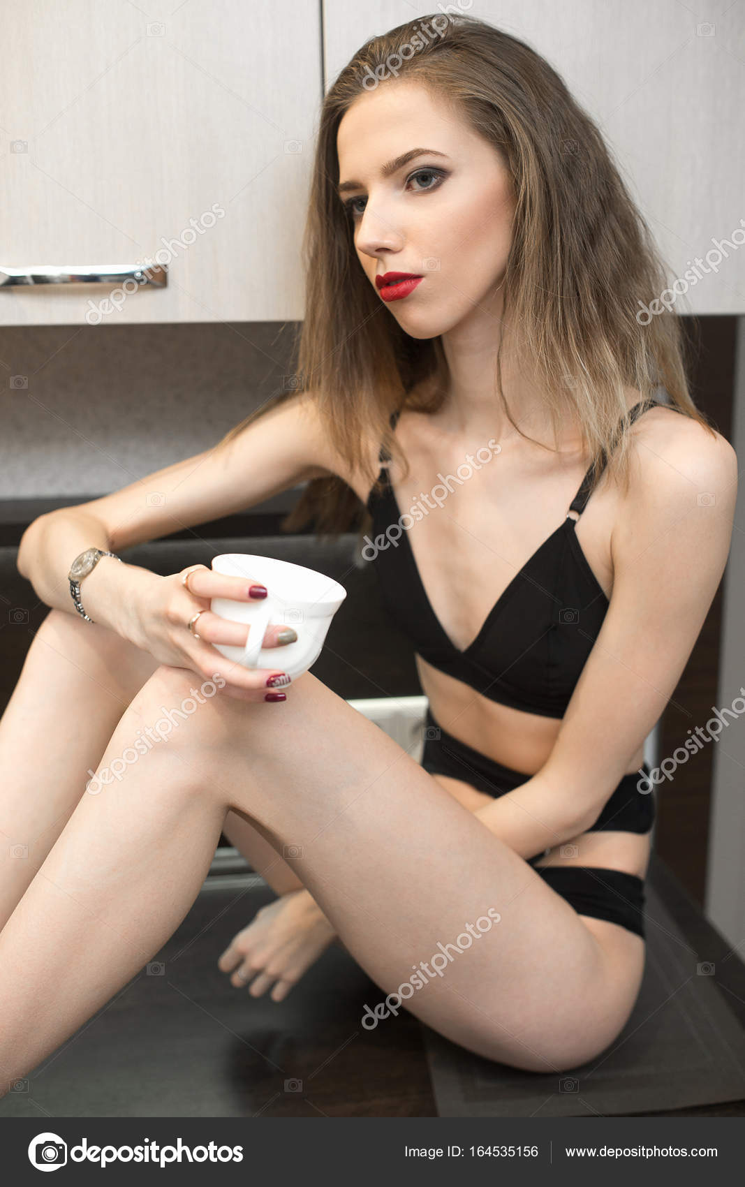 077fd9ae1a Beautiful young sexy woman drinks hot coffee at home — Stock Photo ...
