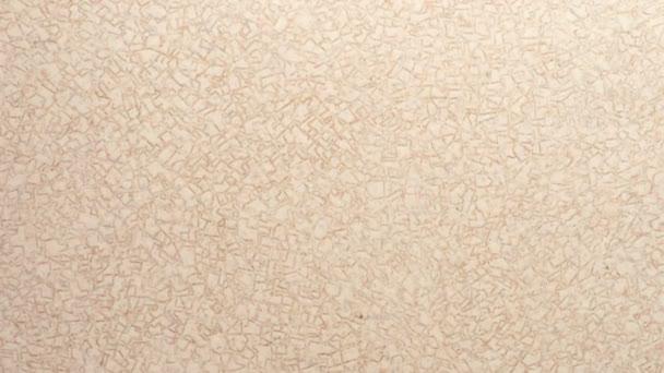 Struttura beige del linoleum con un piccolo modello. Sfocatura