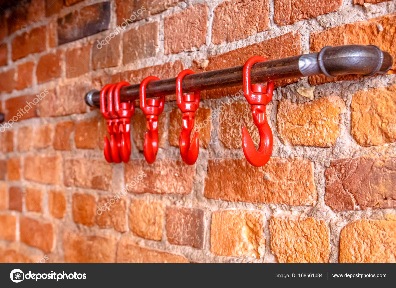 Red hooks on the brick , as decorative elements brutal bar or re