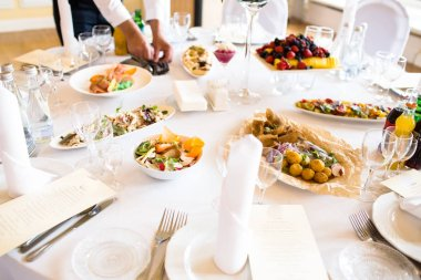 Set the table with different dishes for a Banquet.