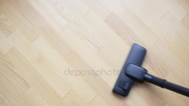 Housewife Use A Vacuum Cleaner Brush On A Parquet Floor