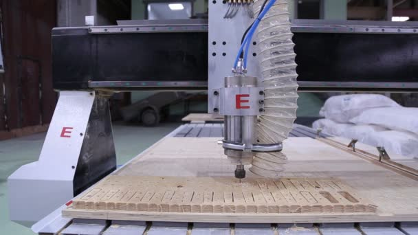 Processing of wood panels on CNC coordinate milling woodworking machine.