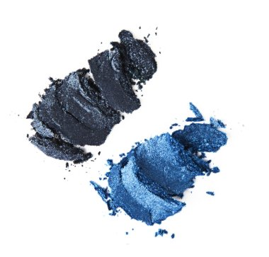Light blue and indigo crumbled eyeshadows on white background stock vector