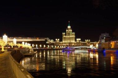Christmas illuminations on the Moskvoretskaya and Raushskaya embankments. High-rise building on Kotelnicheskaya embankment, Moscow, Russia