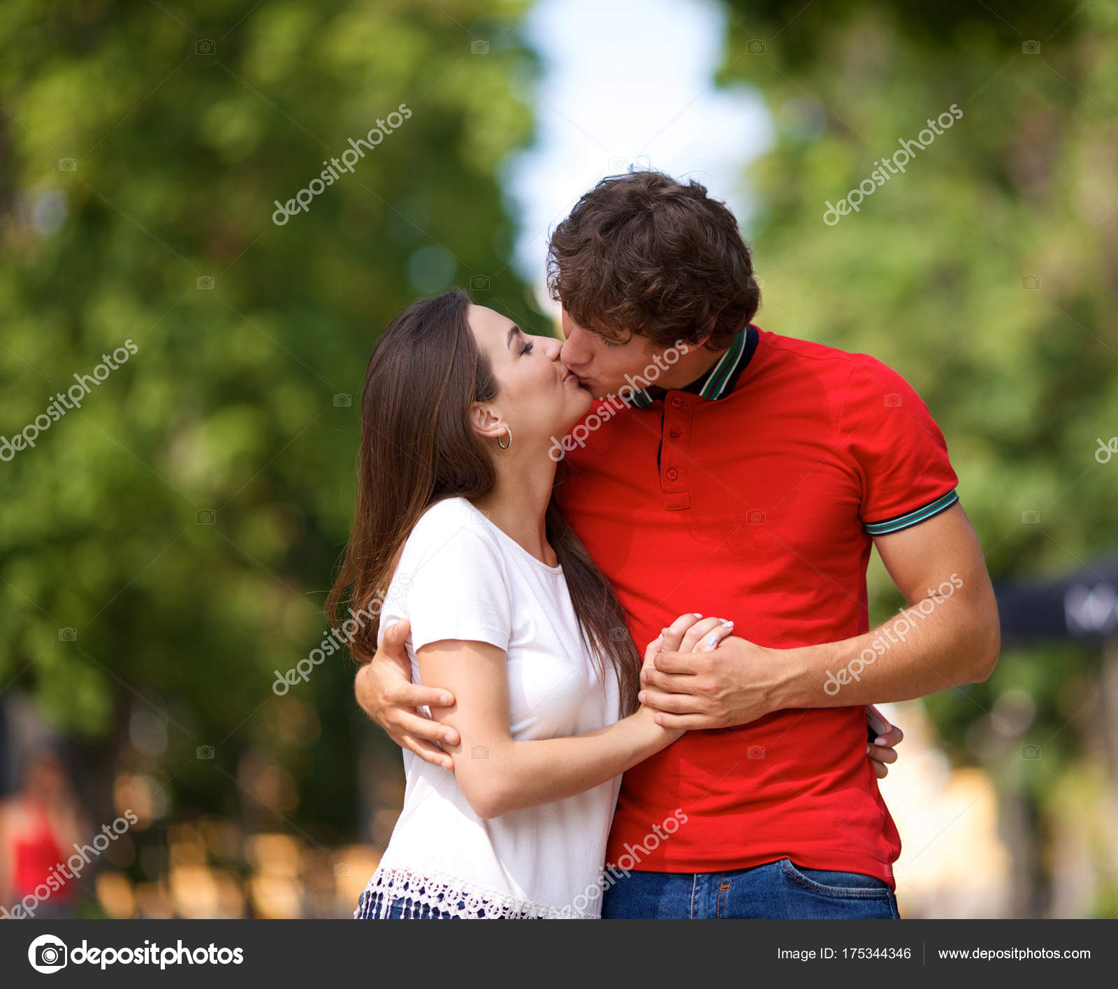 Young Couple Kissing In The Park Stock Photo C Kivphotomaker