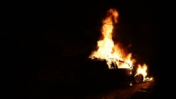 Car burns at night. Side view