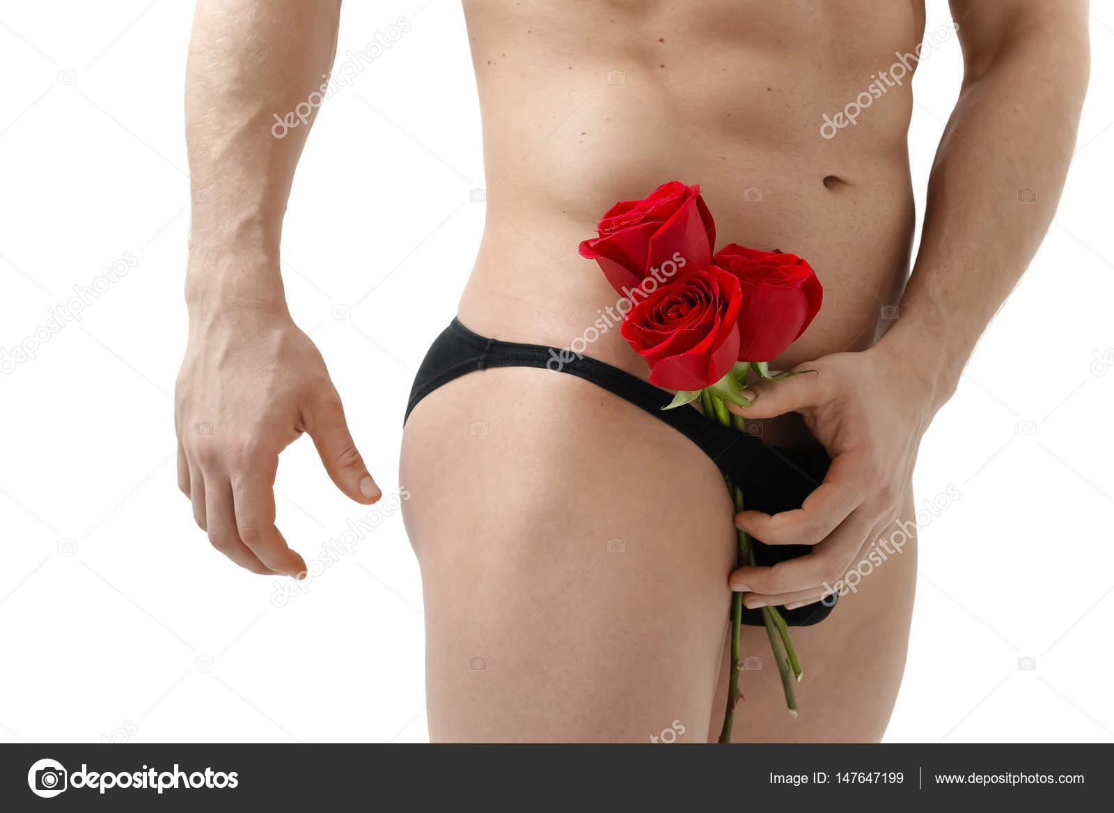 Sexy Hombre Da Una Rosa Sobre Un Fondo Blanco Con Una Hermosa Luz