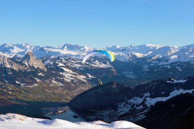 Swiss Alps panoramic view with Hang-glider flying