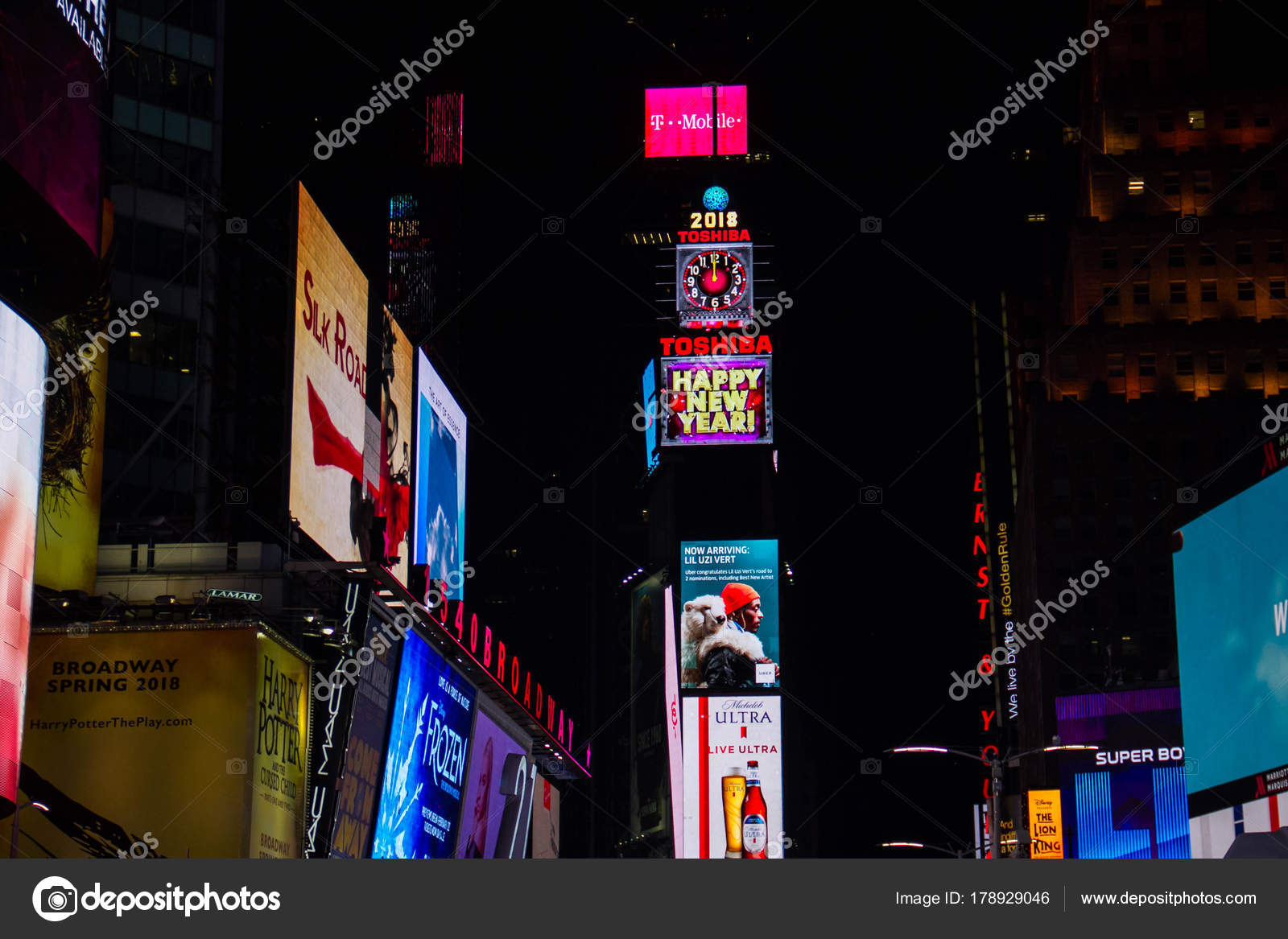 manhattan new york january 1 2018 happy new year billboards on buildings at times square in nighttime photo by spinel_s