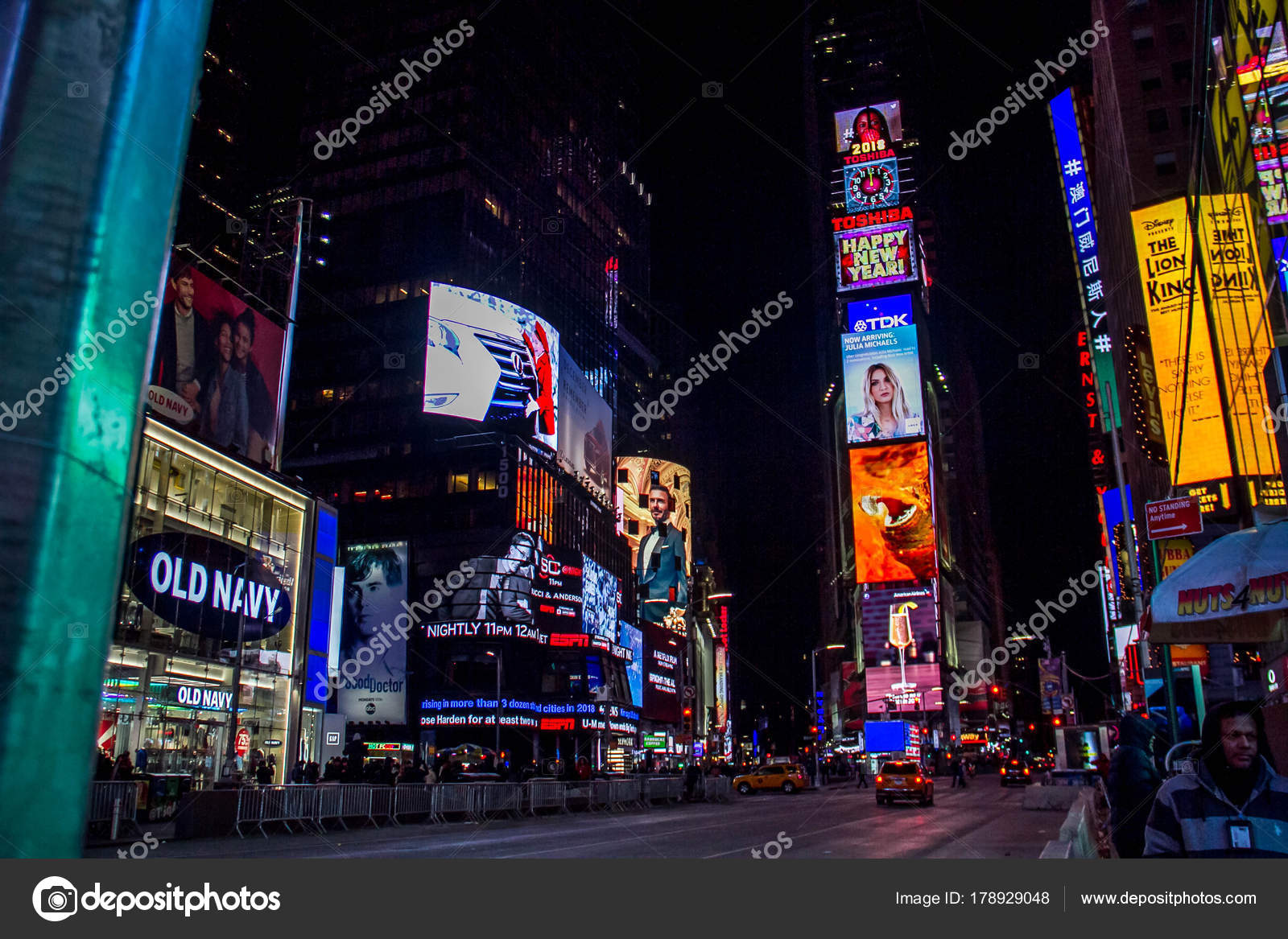 manhattan new york january 1 2018 happy new year 2018 clock graphic and advertising billboards on buildings at times square in nighttime photo by