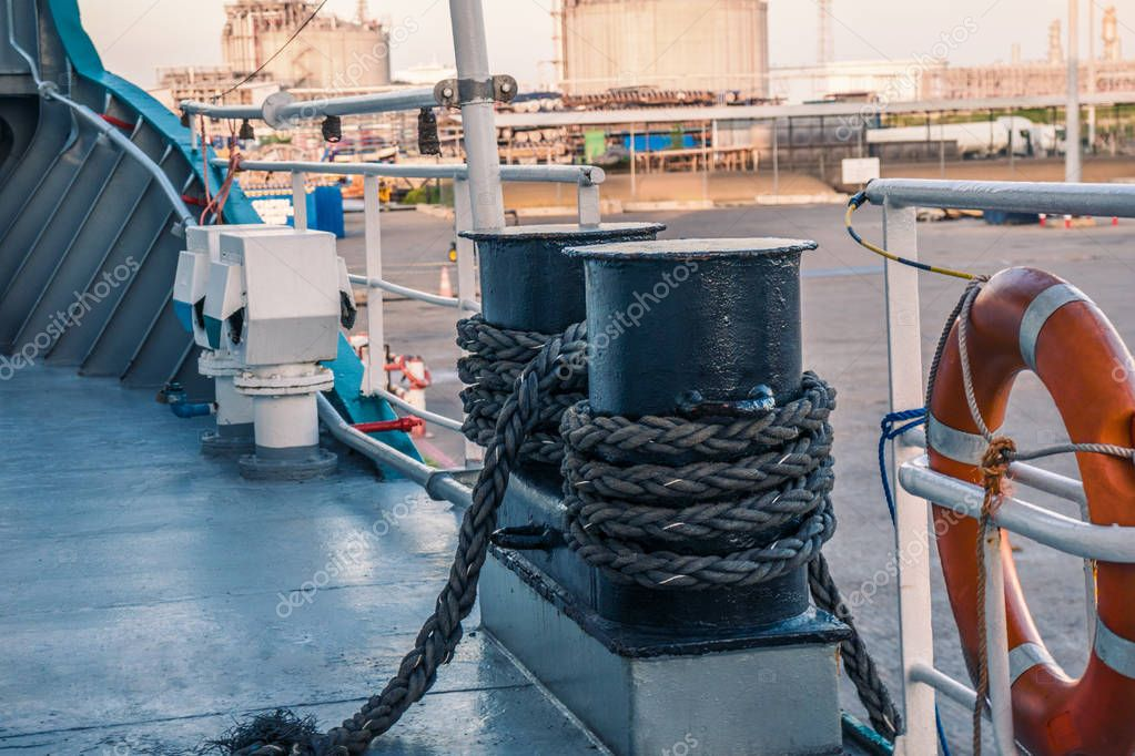 mooring equipment of ship. Mooring lines are fast on bollards, capstan and winch