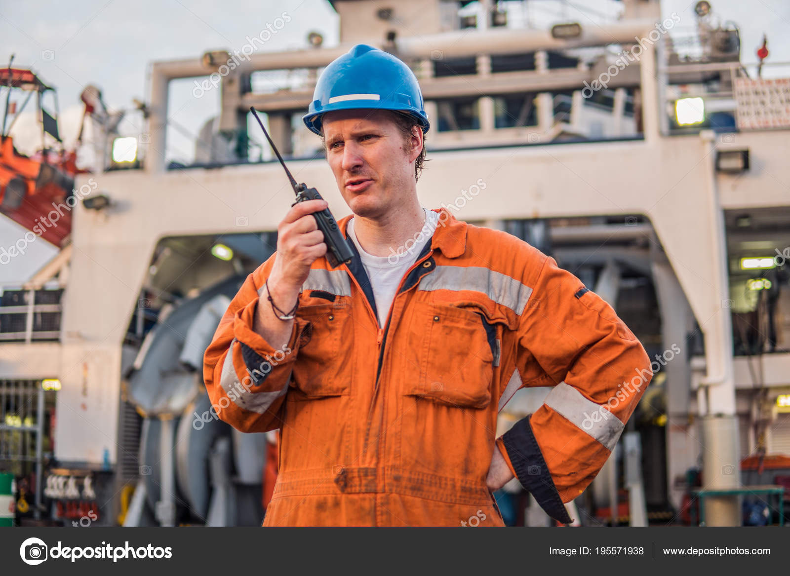 Marine Deck Officer or Chief mate on deck of ship with VHF radio