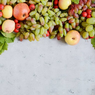 Textural background with fruit cake from grapes, apples, berries