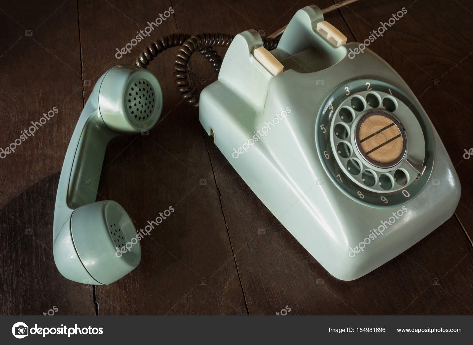 Old Green Vintage Telephone Phone Land Or Landline With Dust On Wooden Retro Desk Copy Space For Text
