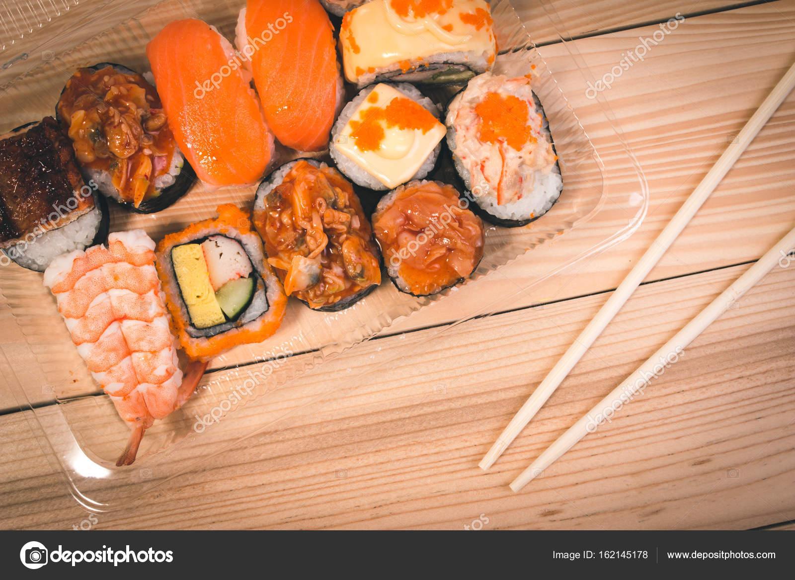Japanese food Sushi in plastic box on Japanese table. Set of Sushi ...