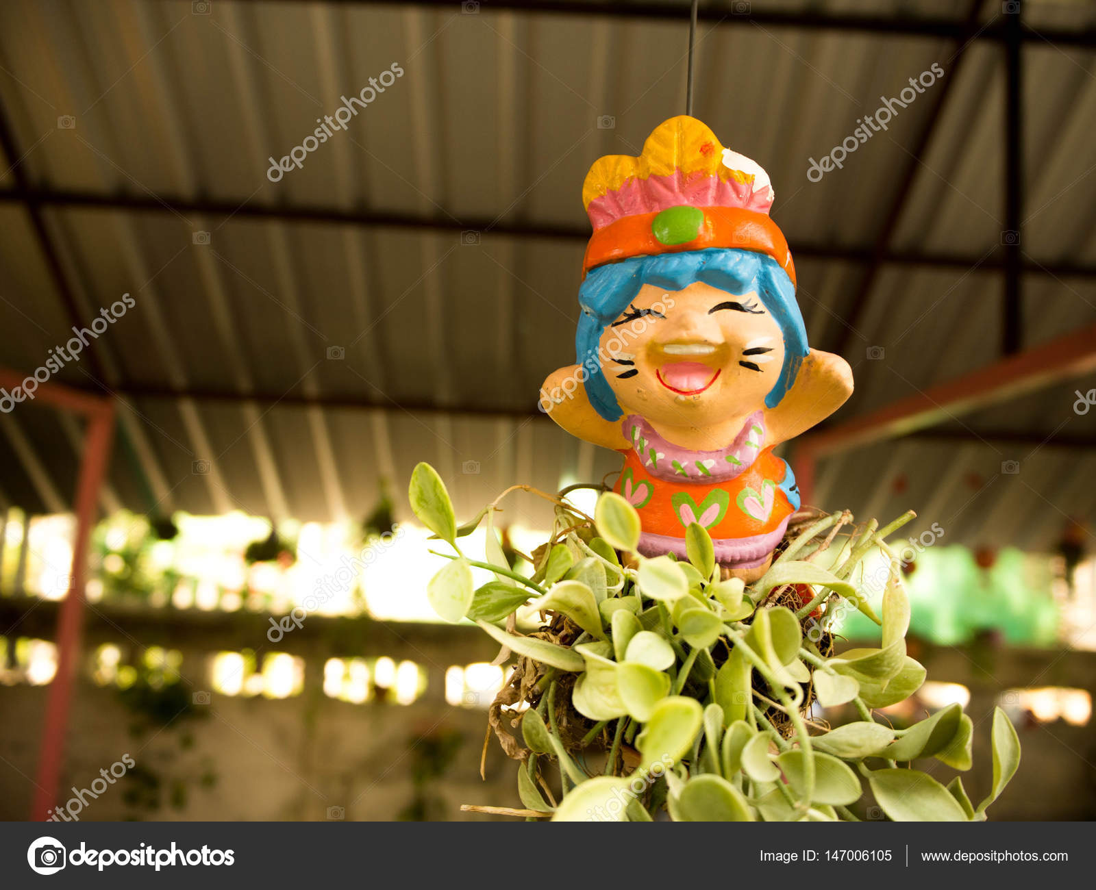 Smiling Lovely Thai Greeting Clay Doll For Welcome Stock Photo